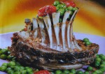 Coroa de cabrito com legumes